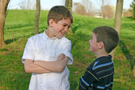 Two Boys Talking and laughing in the park