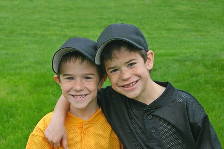 Brothers In Baseball Uniforms Stock Photo