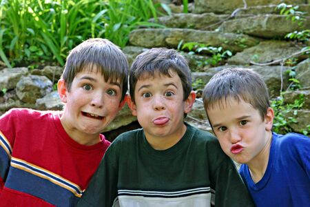 Three Boys All Making Silly Faces Stock Photo