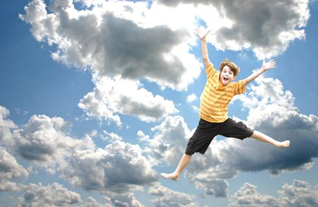 Boy Jumping in the Sky Stock Photo