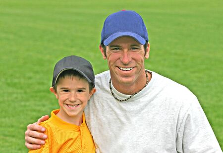 Father and Son Wearing Baseball Hats photo