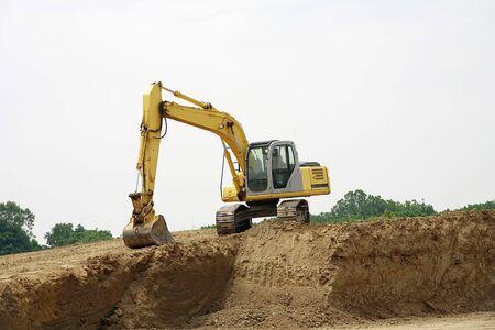 back hoe: Backhoe on a Pile of Dirt