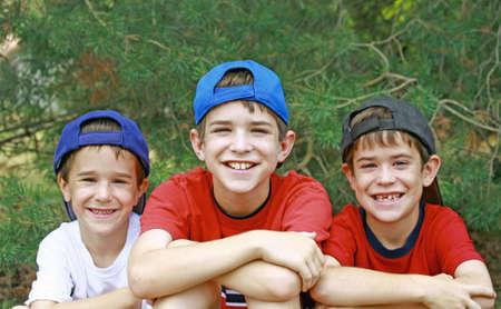 Boys Wearing Baseball Hats photo