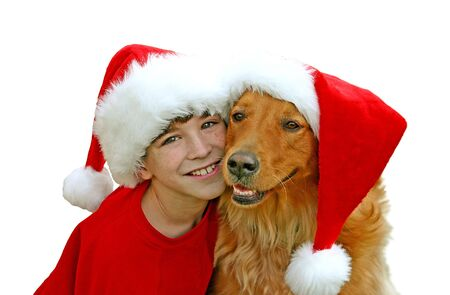 Boy and Dog in Christmas Hats Stock Photo - 1328742