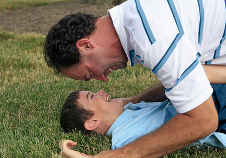 Man Playing with Boy photo