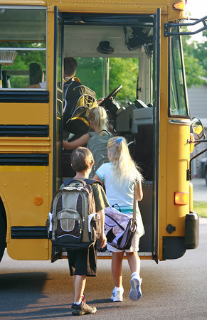first day: Kids Getting on School Bus