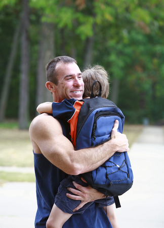 first day: Father Hugging Son Before School