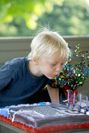 blowing out: Boy Blowing out Birthday Candles