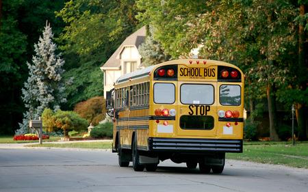 public schools: School Bus in Neighborhood Stock Photo