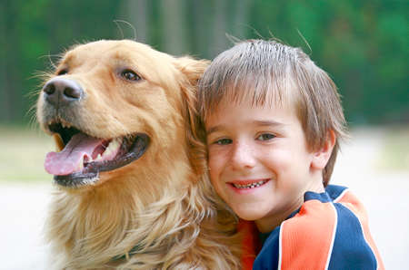 Boy Hugging Dog Stock Photo - 1667580
