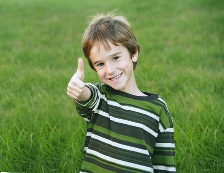 thumb's up: Boy Giving a Thumbs Up