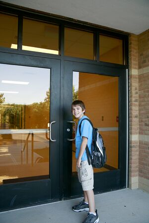 Boy Going into School Stock Photo