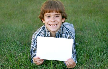 Boy Holding Sign Stock Photo