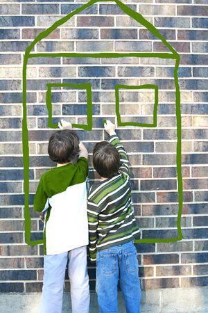 children painting: Children Writing on Brick Wall