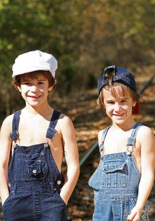 overol: Boys Running Away  Foto de archivo