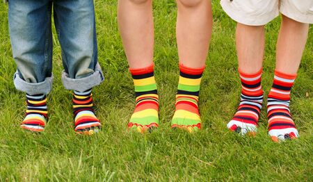 kids feet: Colorful Socks Stock Photo