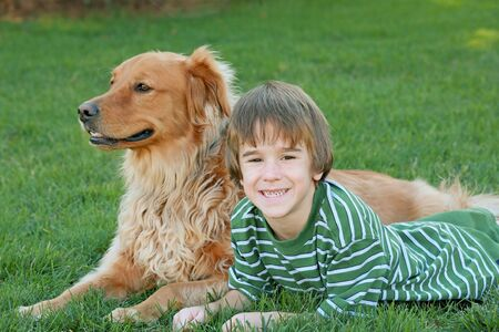 Little Boy Laying Down With Dog Stock Photo - 2010688