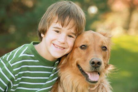 Boy with Golden Retriever Stock Photo - 2083816
