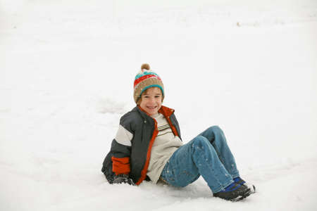 Boy Playing in the Snow Stock Photo - 2327595