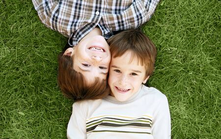 Boys Laying in the Grass Stock Photo - 2365674