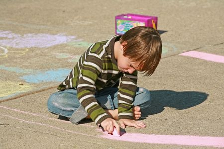 Boy Coloring with Chalk Stock Photo - 2404287