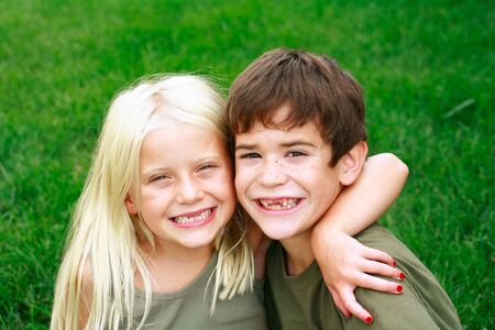 Two Kids With Missing Front Teeth