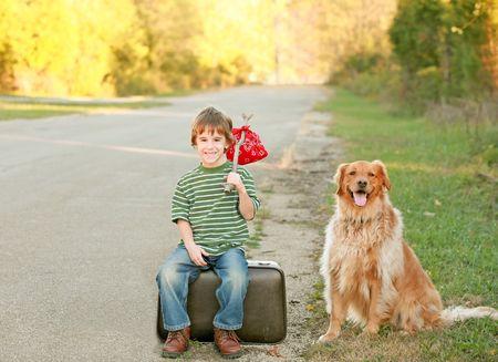 Boy Traveling with Dog Banco de Imagens