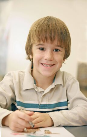 Boy coloring  photo