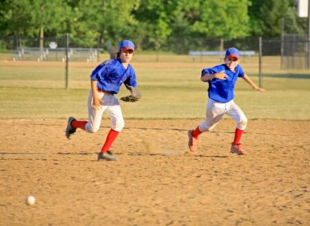 Boys Running for the Ball photo