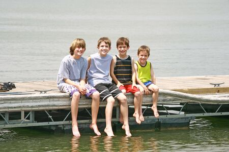 Boys Sitting on the Dock Stock Photo