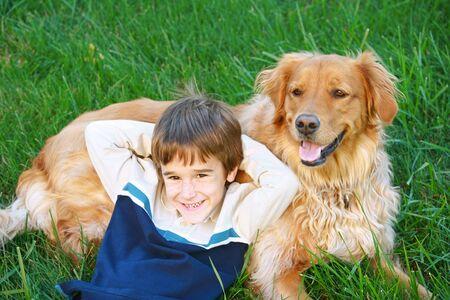 Boy and Golden Retriever Stock Photo - 2485866