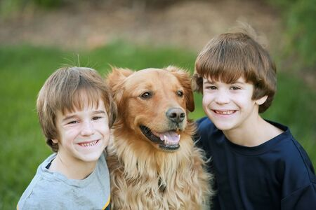 Boys Smiling with the Dog Stock Photo - 2485875