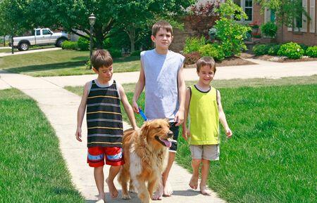 Kids Walking the Dog photo