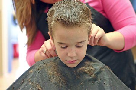Little Boy Getting a Hair Cut photo