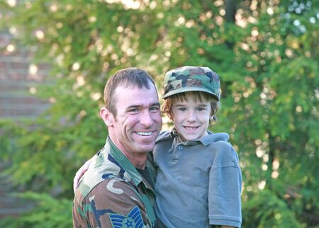Military Father Holding Son Stock Photo