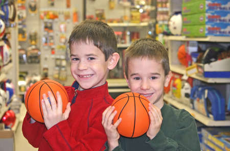 Boys Holding Basketballs photo