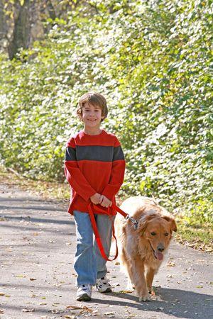 Boy Walking the Dog Banque d'images