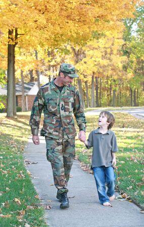 Dad and Son Walking Standard-Bild