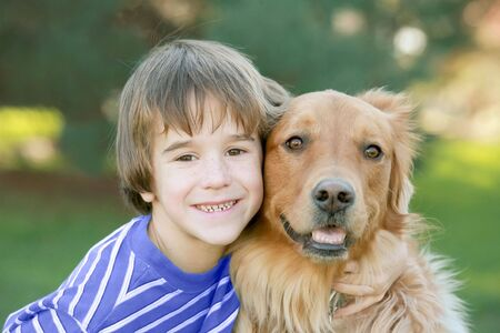 Boy Hugging Dog Stock Photo - 2649967