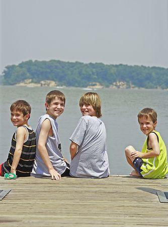 model fish: Boys on a Fishing Dock Stock Photo