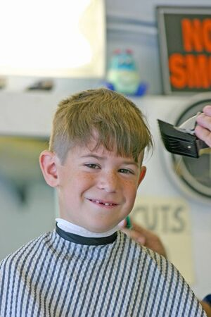 Little Boy Getting a Hair Cut Stock Photo - 2796312