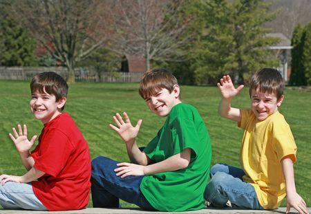 bros: Three Boys Waving Stock Photo