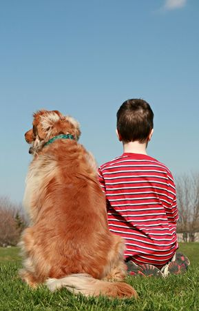 backs: Boy and Dog Sitting on a Hill