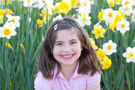 Little Girl in Front of Daffodils Stock Photo - 2894779