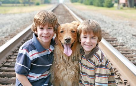 Dog and Boys on Railroad Tracks photo