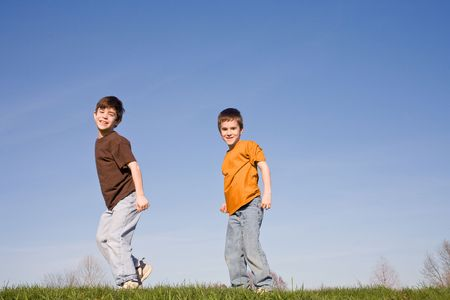 Boys Walking on a Hill Stock Photo - 2919224