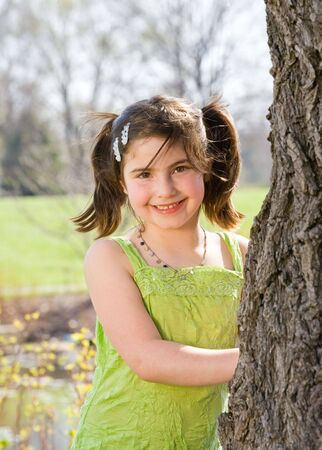Cute Little Girl Beside a Tree  Stock Photo - 2919227
