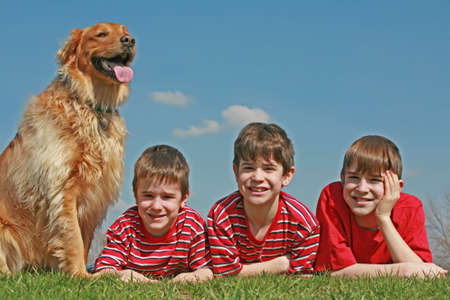 Boys Laying With the Dog Stock Photo - 2949564