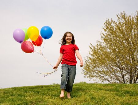 birthday party kids: Girl Running With Balloons Stock Photo