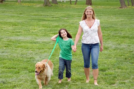 Mother and Daughter Walking the Dog Stock Photo - 2993541